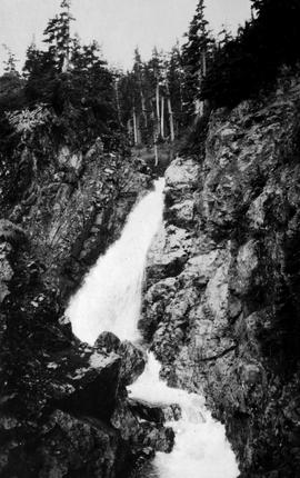 Swannell Survey; waterfall through a rock cut