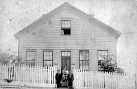 Mrs. Robert Austen Brown and her children in front of their home at 65 Collinson Street, Victoria.