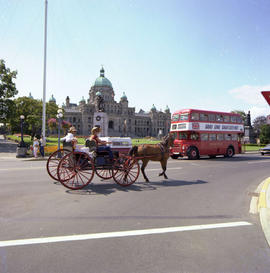 Double decker bus, carriage ride; in front of the Legislature, Victoria.