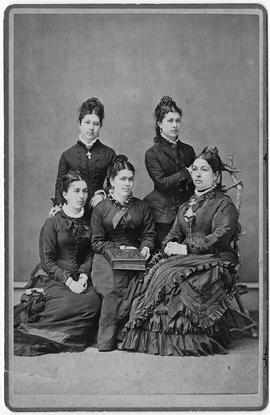 W.H. McNeill family, back row: L-R, Mrs. Jones, Mrs. Baker, front row: L-R, Mrs. Judson Young, Mr...