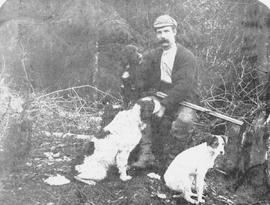 An unidentified Sooke hunter and his dogs