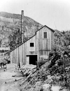 Josie Mine, shaft house and compressor plant, Red Mountain in the background, Rossland.