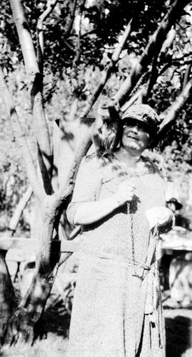 Artist Emily Carr and Woo the monkey, perched on her right shoulder, in backyard, Simcoe St., Vic...