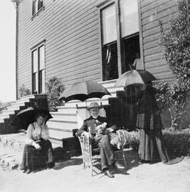 Rout Harvey, Sr. at his home, Stoneyhurst, 1369 Rockland Avenue, Victoria; with his sister, Susannah; other woman unidentified.