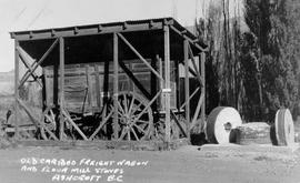 """Old Cariboo Freight WAgon and Flour Mill Stones, Ashcroft, BC."""