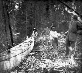 Portaging a canoe with a Spanish windlass, Deserters Canyon, Finlay River.