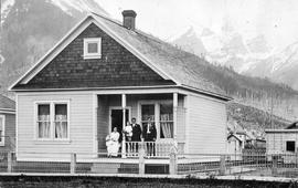 Unidentified family on the porch of their Fernie home.