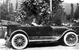 Unidentified woman driving an automobile; box 2.
