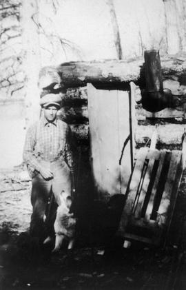 Bob Farrel in front of his cabin at Fort St. John.