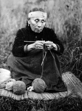 First Nations woman knitting on four needles.