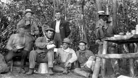 A group of surveyors in camp; Frank Swannell second from the right.
