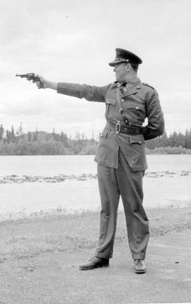 A member of the BC Provincial Police demonstrating the improper stance for shooting.