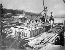 """Dredgin pier No. 3""; construction of the Fraser River Bridge in New Westminster."