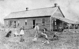 George Chadsey outside of his home with his family; Chilliwack.