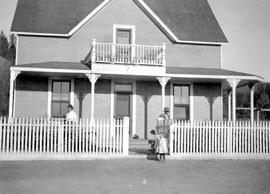 Mr. and Mrs. Robert Yorston, outside their home at Australian Ranch.