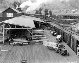 Chase. Adams River Lumber Co. Loading Freight Cars