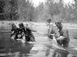 Survey crew fording the Bonaparte River during the survey of First Nations reserve no. 1A.