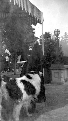 A woman with a large dog on the verandah of Hatley Park Castle; box 3.
