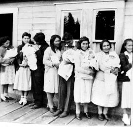 A group of young mothers at Ahousaht; babies to be baptised