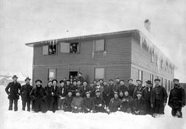 """Group of miners at bunkhouse, CNP Coal Co., Fernie, BC."""