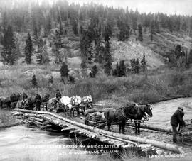 """Freight teams crossing bridge, Little Nalin River; Atlin-Quesnelle tel. line."""