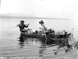 Gold and Kastberg using a canvas boat on Tatla Lake.