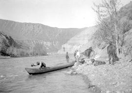 Baling the canoe at the ford of the Chilcotin.