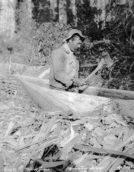 Alexander making a canoe during exploratory survey of the Finlay River near Fort Grahame.