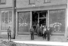 """The Gluepot Saloon, D. Maglio, Proprietor""; Nelson BC; Grand Hotel to the left; man wi..."
