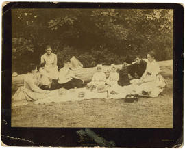 A family picnic.  Emily [Carr ]seated at back, left.