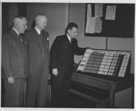 Mr. Percy McKergow (left), Director of Civil Defence, City of Vancouver; R.J. Manion (center), Fe...