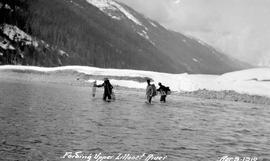Survey party fording the Upper Lillooet River.
