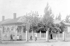 The Alex A. Green home on Birdcage Walk; Mrs. Green and Mrs. Cridge are standing in the gateway.
