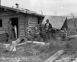 Hastberg, Ross and Flameau at cabin near Fort Grahame on the Finlay River.