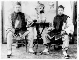 Victoria; Portrait Of Two Unidentified Young Chinese Men In Traditional Costume.