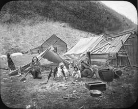 A native family cooking salmon along the Fraser River.