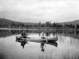 Two surveyors canoeing Divide Lake in the Highland Valley.