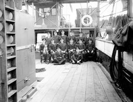 The officers and ship's dog of HMS Shearwater.