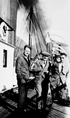 Swannell Survey; group of four men aboard ship.