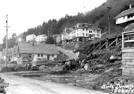 Ocean Falls; clearing the site for the Kimsquit Lodge girls' dormitory at Burma Road and 5th Street West; No. 3 or Balsam Apartments is on the hill above; from volume 14, unbound 19