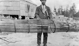 A man with an Indian fishtrap at Kyoquot.