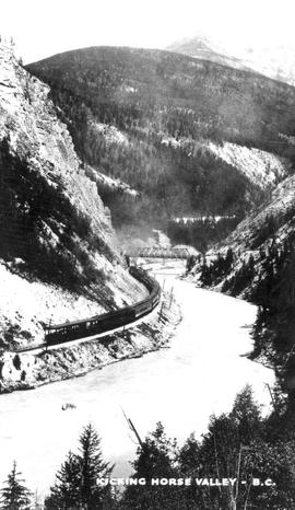 """Kicking Horse Valley, BC""; passenger train along banks of Kicking Horse River with bri..."
