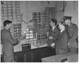 Mayor Hamilton (centre) Port Alberni, is given explanation of control room facilities in that city