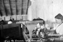 Richmond; BC canneries; women filling cans.