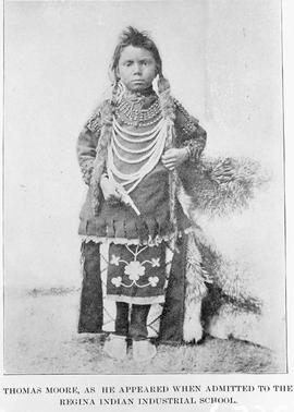 """Thomas Moore as he appeared when admitted to the Regina Indian Industrial School."""