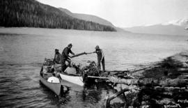 Crew moving camp at Tahtsa Lake.