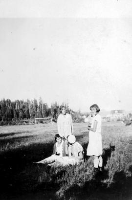 Ahousaht Residential School, four girls on the playing field
