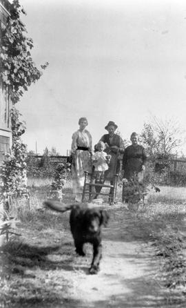 Mr. and Mrs. Lancelot Grimmer and family; the family dog coming to investigate the photographer.