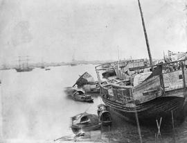 [Canton, China]  20.  River scene, taking in the remains of an old junk or two the Marceau French...