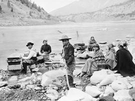 A First Nations family placer mining with sluice boxes and gold pans at the confluence of the Tho...